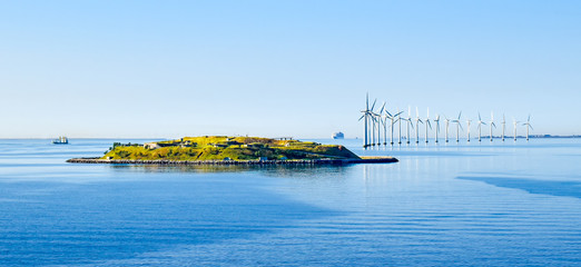 Island Middelgrundsfortet and offshore wind turbines on the coast of Copenhagen in Denmark