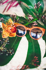 Flower and sunglasses display