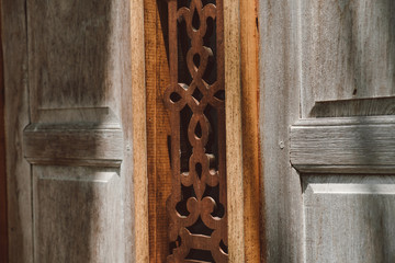 Wood texture background with light and shadow and thai carve