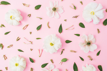 Floral pattern with white spring flowers and leaves on pink background. Floral background. Flat lay, top view.