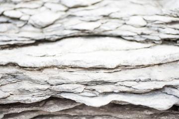 Papiers peints Marbre Textural stratified rocks in light gray cool tones
