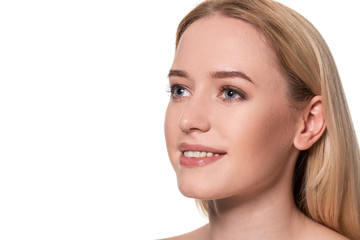 Beautiful face of young blond woman with clean fresh skin and natural make up on white background.
