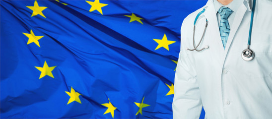 Concept of national health care and medicine system in EU. Confident professional doctor in white coat with stethoscope