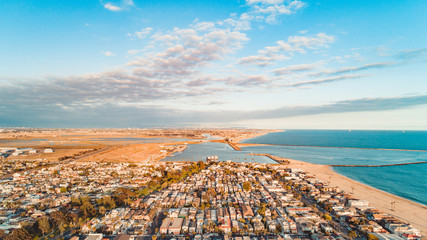 Aerial of a neighborhood by the beach