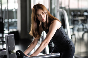 Fitness woman in training exercises with dumbbells.