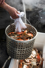 Chef steaming blue crabs