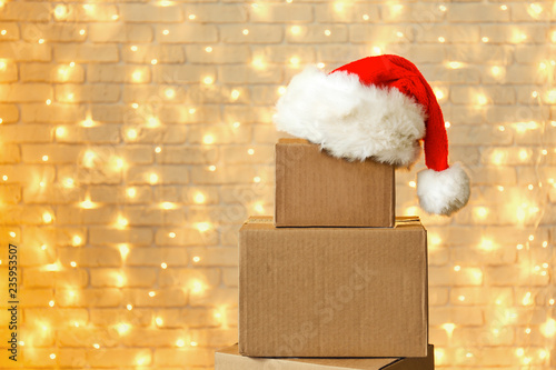 5049bbe77 Blank brown freight box with Santa Claus hat on top, brick wall with ...