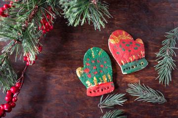 hand painted Christmas mitten salt dough ornaments on festive wood table