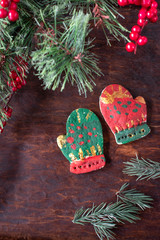 hand painted Christmas mitten salt dough ornaments on festive wood table