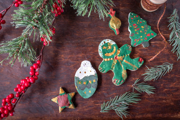 hand painted Christmas salt dough ornaments on festive wood table