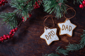hand painted Christmas star ornaments for two dads on festive wood table