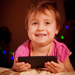 Social Media addiction. Portrait of smiling little child girl with mobile phone (psychological problems, media mania, education concept)