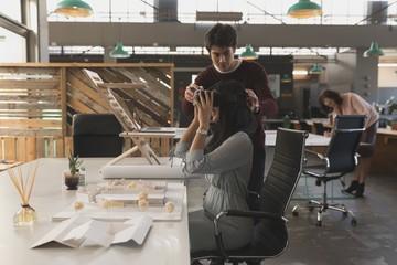 Executives using virtual reality headset at table
