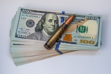 United States currency 100 dollar banknotes and cartridge