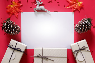 top view of gift boxes on red background with white space for your text.