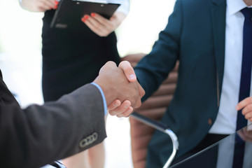 closeup. handshake of business partners in the office.