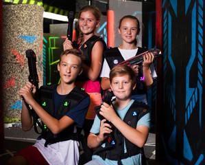 Teen kids with laser guns