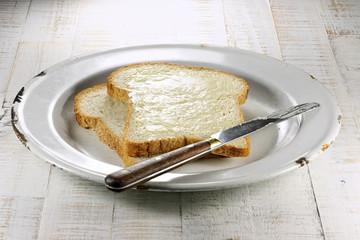 buttered white bread on enamel plate