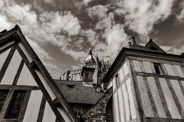 photo of beautiful roofs of wonderful buildings on the wonderful blue sky background . Image in black and white color style