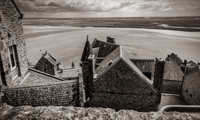 photo of beautiful roofs of wonderful buildings on the wonderful sea and field background . Image in black and white color style
