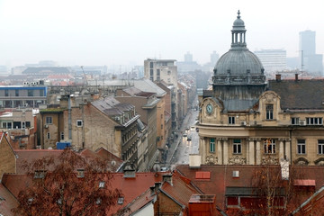 Autumn leaves and historic buildings in Zagreb, Croatia. Selective focus.