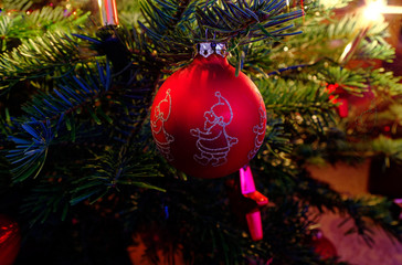 Christmas bauble on a Christmas tree and glowing lights