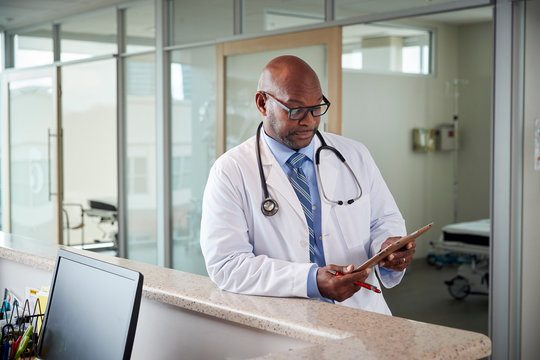 Doctor posing in medical office