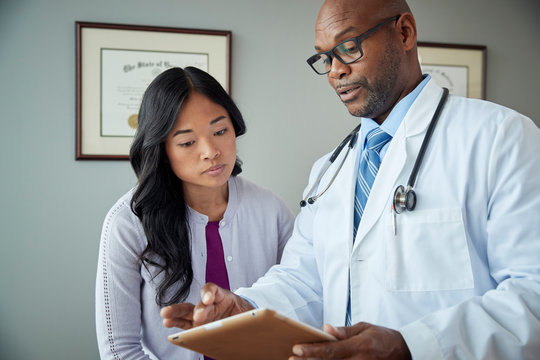 Doctor and patient review medical results