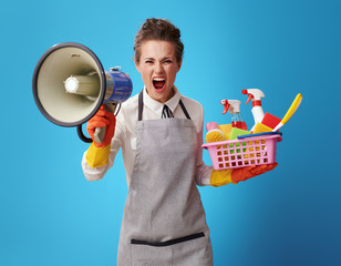 cleaning lady with a basket with cleansers and brushes shouting