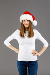 Beautiful woman in Santa Claus hat