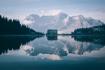 View of Lago Misurina with snowcapped mountains in background