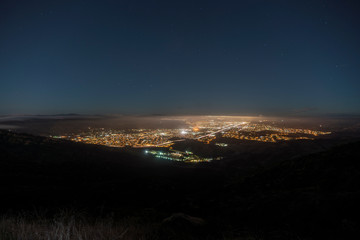 Foggy night hilltop view of suburban Simi Valley near Los Angeles in Ventura County California.