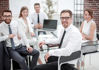 boss and business team sitting at their Desk