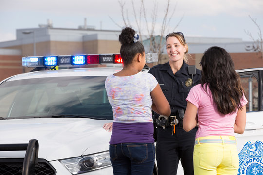 Policewoman talking to two young girls