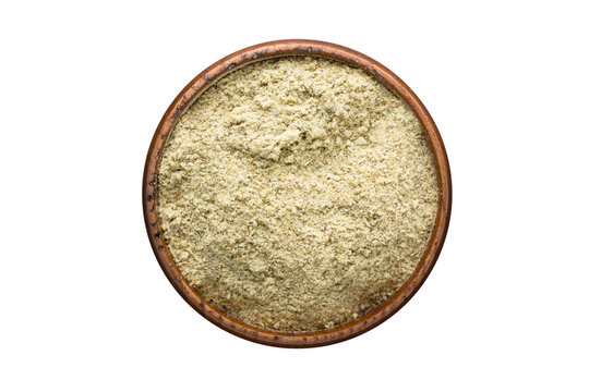 Blue Fenugreek Powder spice in wooden bowl, isolated on white background. Seasoning top view