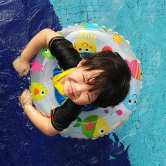 Overhead view of boy swimming in pool
