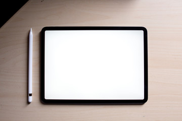 new pro tablet on the table with pencil blank screen