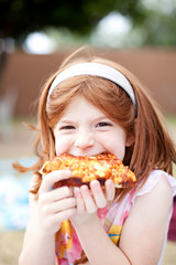 Portrait of a girl eating pizza