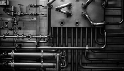 Close up of pipes on the wall in a brewery
