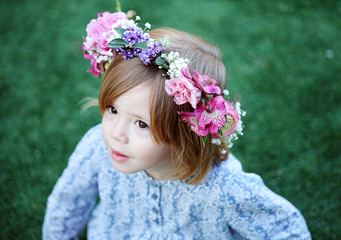 Girl wearing flower wreath while standing outdoors