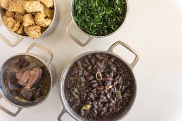 Ingredients of feijoada, typical food of Brazil