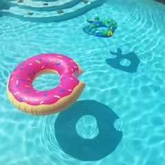 Pink inflatable ring floating in swimming pool