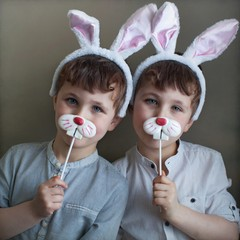 Twin boys wearing rabbit ears during Easter