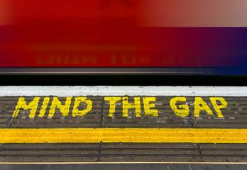 Close up of mind the gap warning sign