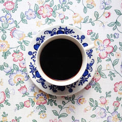 Overhead view of coffee cup served on table