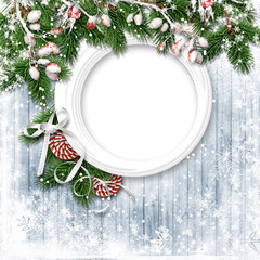 Christmas firtree with holly, snowfal and frame on wooden white board
