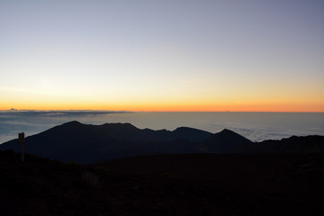 Sunrise at the summit of Haleakala volcano on the island of Maui, Hawaii.