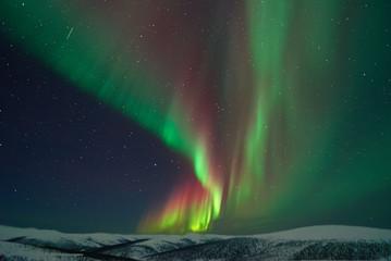 Aurora Borealis over mountains during night