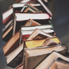 Close up of stack of books in library