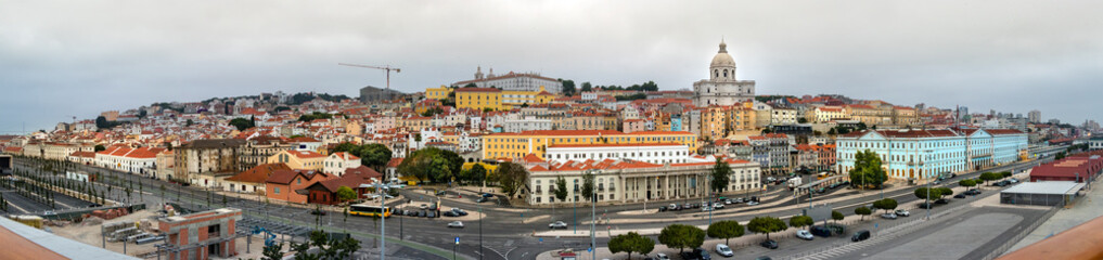Panoramic view from the pier of the Port of Lisbon and the city center on a cloudy day.